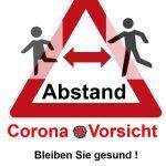 Schild Corona-Vorsicht Abstand halten. Bleiben Sie gesund!